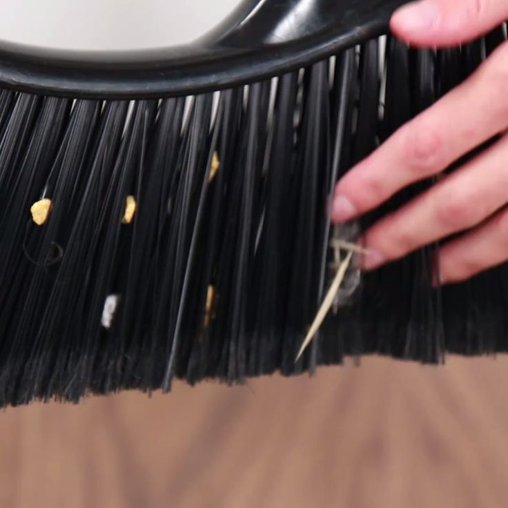 'Clean Dust Bunnies From A Broom With This Clever Hack...!' (via BuzzFee...