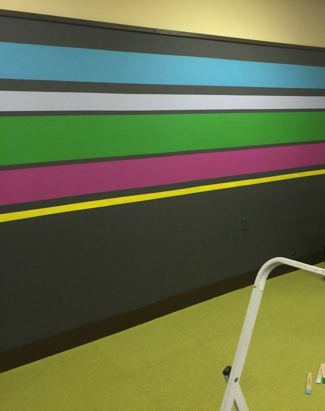Make crisp wall stripes by using Frog Tape.  Kellie Smith Office Makeover