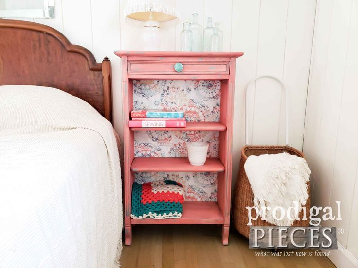 Vintage Coral Bookcase with Boho Vibe and Wallpaper Backing by Larissa of Prodig...