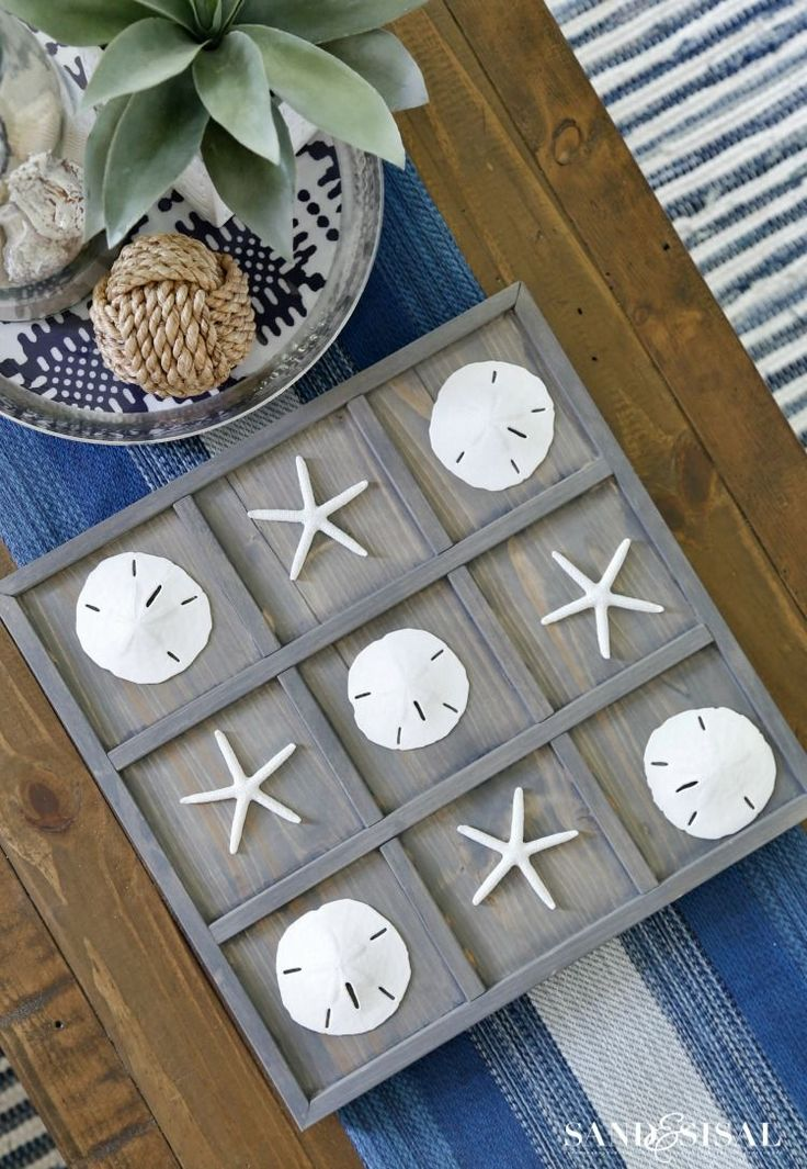 Add a bit of the beach to your home with a DIY Coastal Tic-Tac-Toe board, comple...