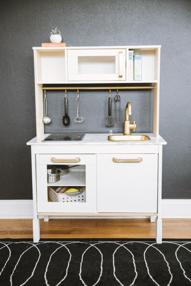Ikea play kitchen hack- marble counter top and gold fixtures!