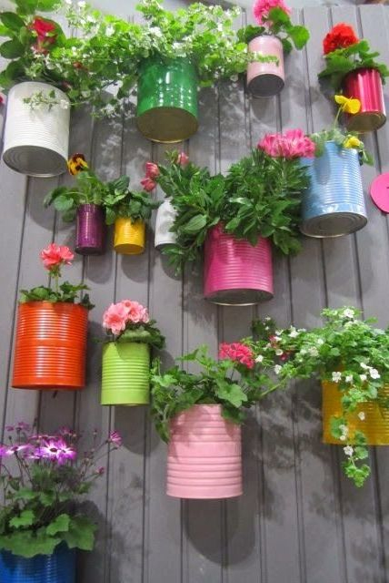 Recycled cans and little bit paint, so colorful and cute! Great idea for a littl...