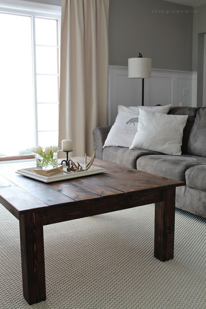Learn how to build this rustic wood farmhouse coffee table at LoveGrowsWild.com!...