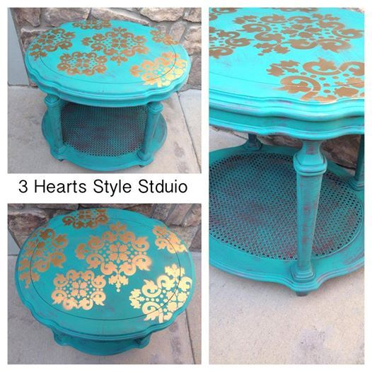 Teal, gold and undercoat of red nightstand or end table.