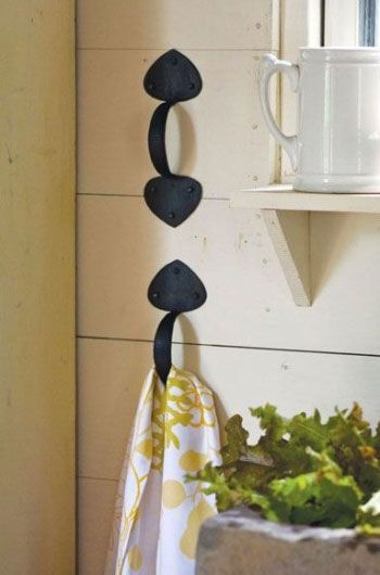 Use Drawer Handles as Towel Holders. Tack handles on the side of a cabinet or ha...