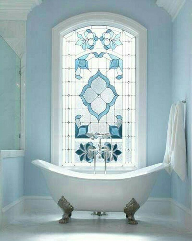 Blue Vintage Bathroom decor with stained glass window.