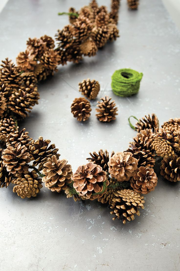 DIY Pinecone garland- will actually use this as a table center piece and decorat...