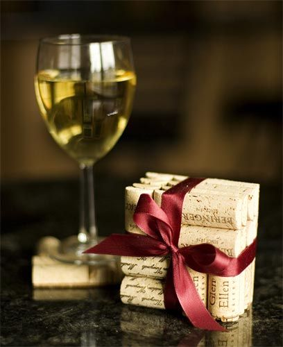 For the wine lover that has everything! Each coaster is made from 4 wine corks c...