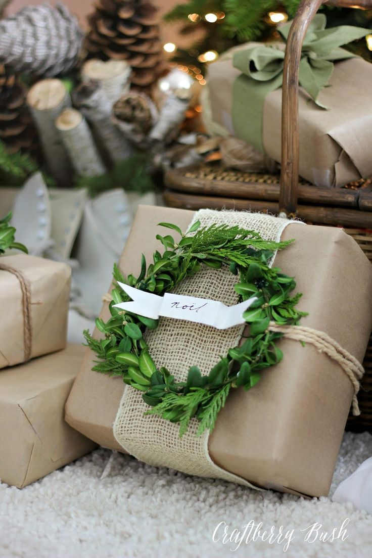Package wrapped in kraft paper and burlap with a boxwood wreath gift tag....beau...