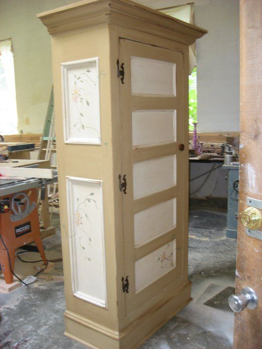 Armoire made with old door.  The side panels were hand painted.