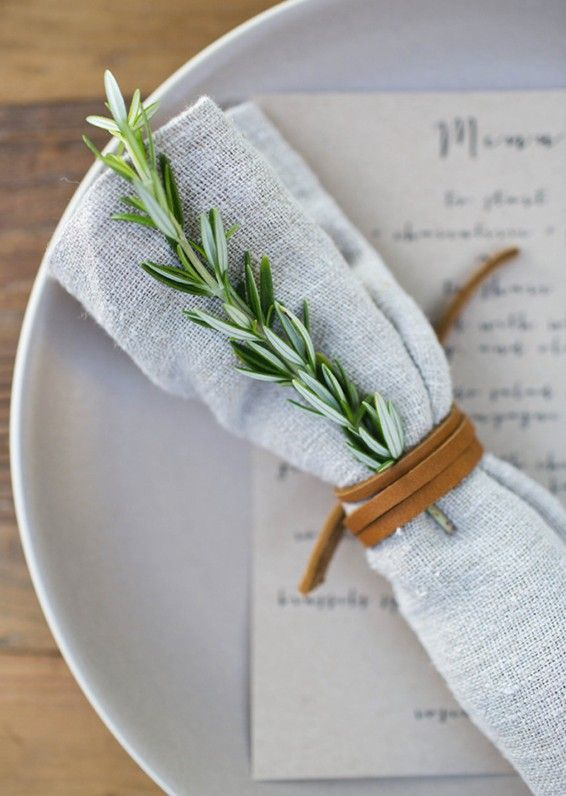 LEATHER CORD-WRAPPED ROSEMARY around a linen napkin for Thanksgiving and holiday...