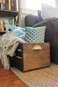 Wooden crate for blankets. You can get these at Michael's, then stain and add ...