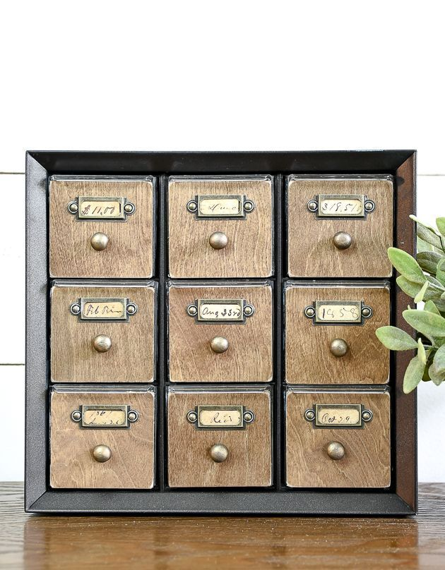 WOW, this makeover is awesome!  Learn how to make a faux card catalog from a har...