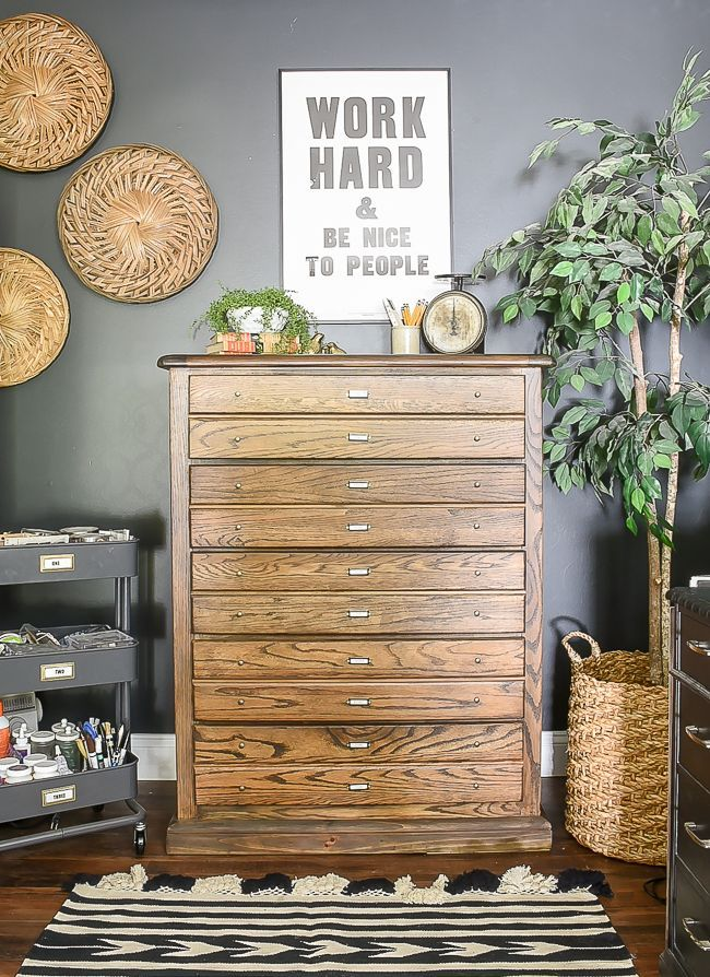 A dated dresser gets a vintage map cabinet inspired makeover with fresh new stai...