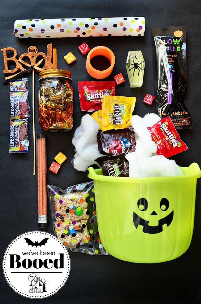 Get in the spirit of Halloween by creating a BOO bundle filled with candies and ...
