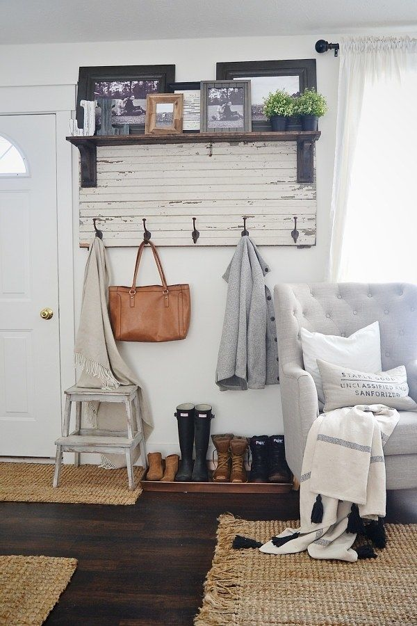 Carve out some space for a (pretty) mudroom with a rustic entryway coat rack and...