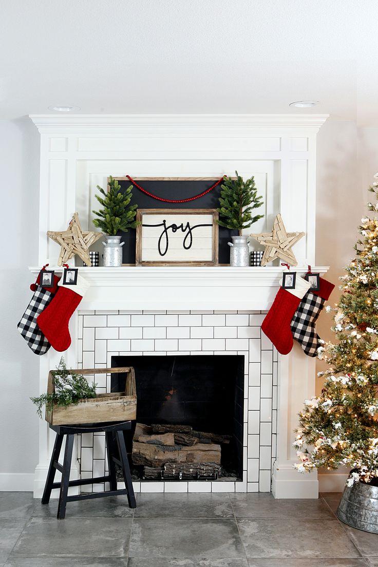 Farmhouse Christmas Mantel | Love the black and white buffalo check with a pop o...