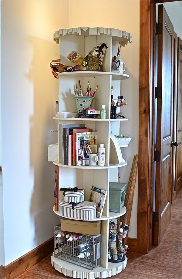 How to make a revolving bookcase.  I made this for $100.  It sits in my craft ro...