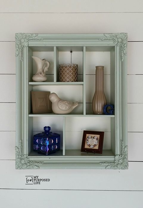 I love the color of this repurposed picture frame into a shadow box with cubbies...