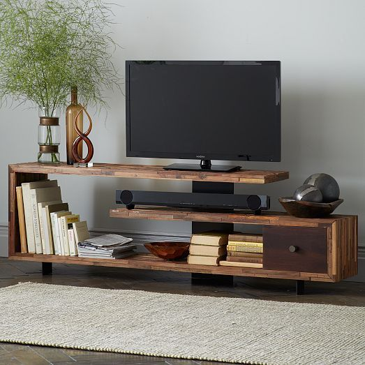 I kind of like this staggered wood console. Open shelf for a sound bar. Thick me...