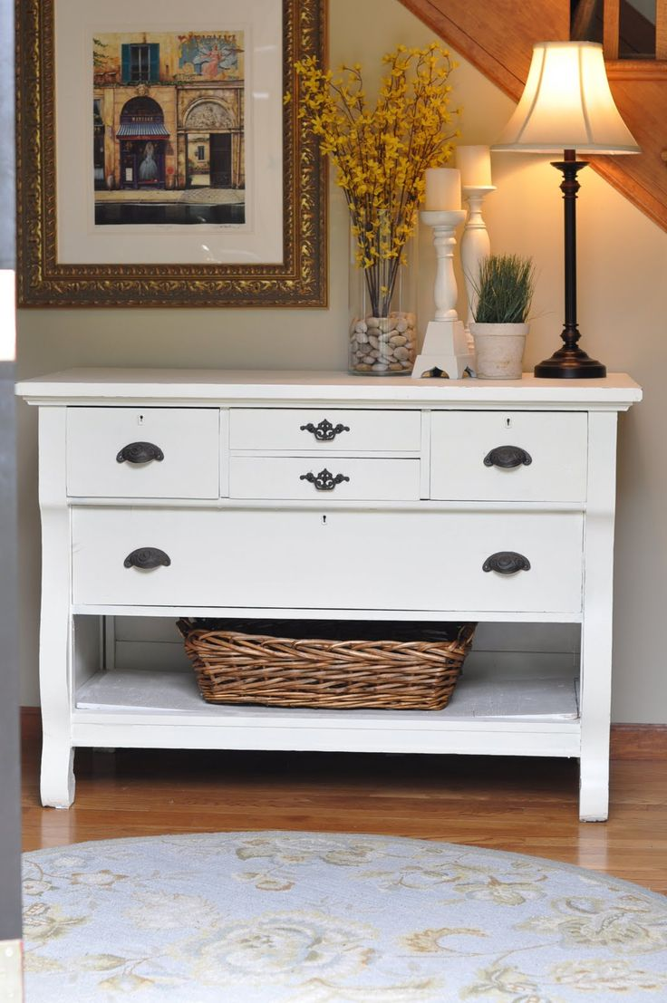 Paint a dresser; take out bottom drawer, add baskets and there is an awesome acc...