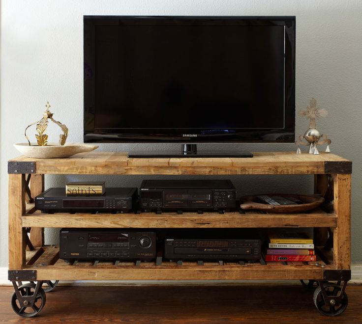 Recycled pine wood + industrial wheels = awesome entertainment console - I would...
