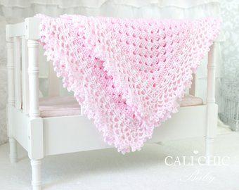 Crochet blanket pattern #147 for the snugly, wide border baby blanket Belle. The...