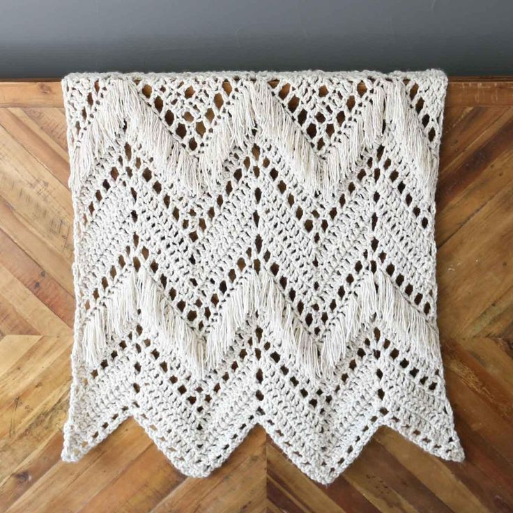 Monochromatic doesn't have to be boring! In this modern fringed crochet blan...