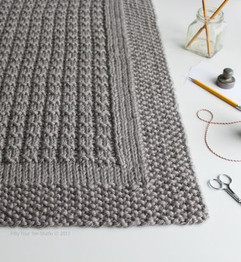 The Over the Rooftops blanket is knit with super bulky weight yarn so it is quic...