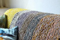 This super simple garter stitch blanket has an I-cord edge and is worked with tw...