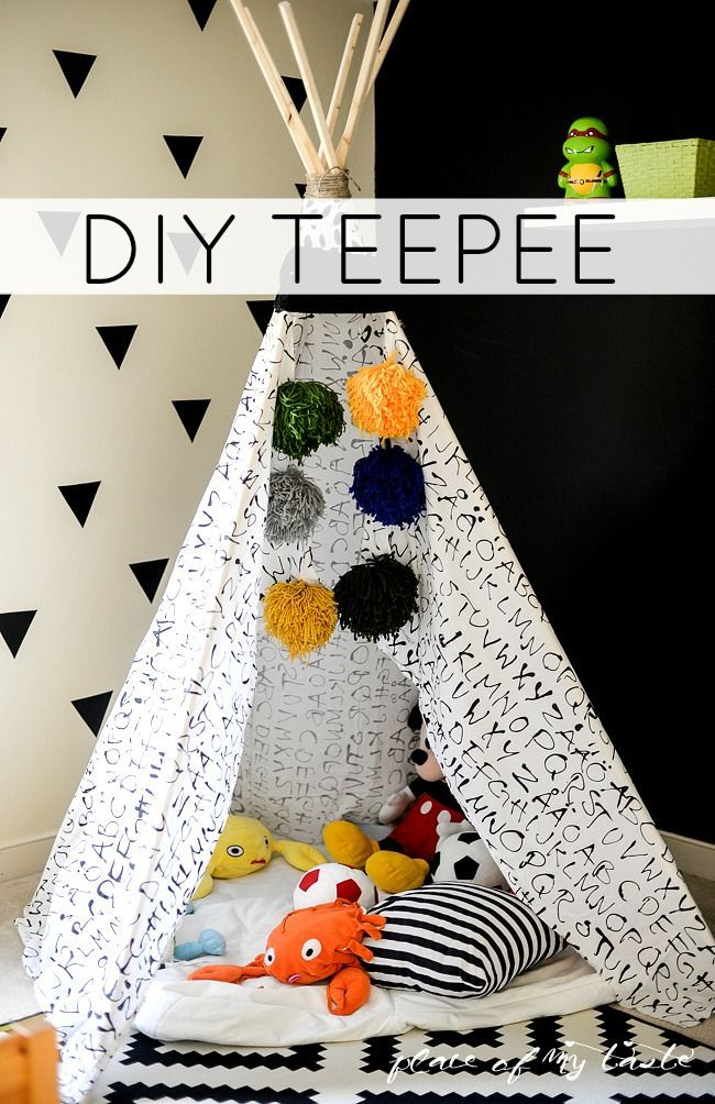 How FUN is this DIY TEEPEE? Used an old bed sheet and made some giant pom-poms t...