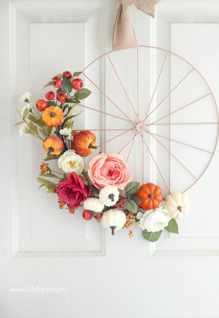 Love this easy fall bicycle wheel wreath! So pretty and festive for autumn and a...