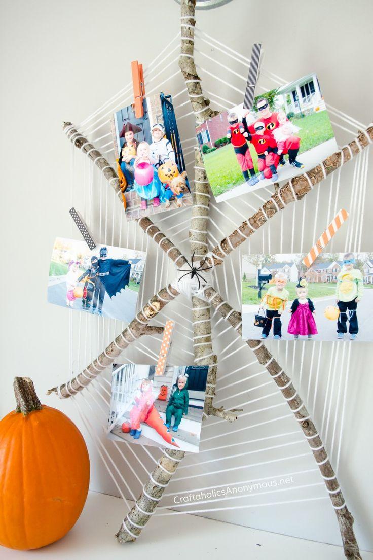 DIY Halloween Photo Display Spider Web  :: great way to show off past Halloween ...