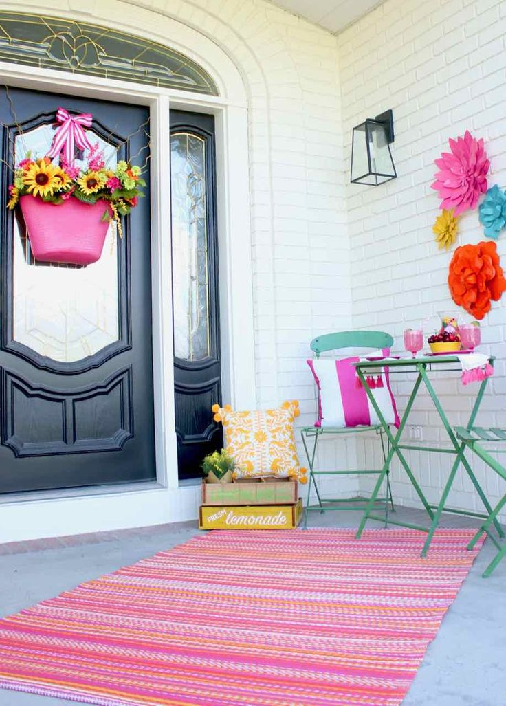 Front Porch Summer Decor. Beautiful hues of pink, yellow, orange, and more make ...